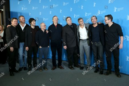 From left, actors Justus Von Dohnanyi, Hugh Bonneville, Dimitri Leonidas, Bob Balaban, Bill Murray, John Goodman, George Clooney, Jean Dujardin and Matt Damon pose for photographers at the photo call for the film The Monuments Men during the 64th Berlinale International Film Festival, in Berlin