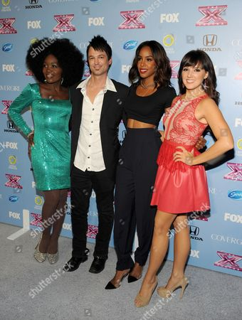 """Stock Photo of From left, contestants Lillie McCloud, Jeff Gutt, judge Kelly Rowland and contestant Rachel Potter arrive at FOX's """"The X Factor"""" Season 3 Finalists Party,, at the SLS Hotel in Beverly Hills, Calif"""