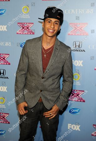 "Contestant Carlito Olivero arrives at FOX's ""The X Factor"" Season 3 Finalists Party,, at the SLS Hotel in Beverly Hills, Calif"