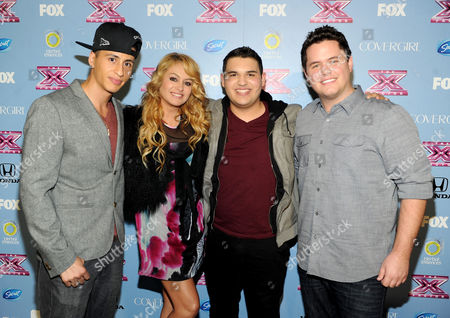 "Stock Picture of From left, contestant Carlito Olivero, judge Paulina Rubio and contestants Carlos Guevara and Tim Olstad arrive at FOX's ""The X Factor"" Season 3 Finalists Party,, at the SLS Hotel in Beverly Hills, Calif"
