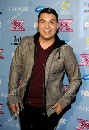 "Contestant Carlos Guevara arrives at FOX's ""The X Factor"" Season 3 Finalists Party,, at the SLS Hotel in Beverly Hills, Calif"