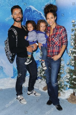 Kamar de los Reyes, left, and Sherri Saum attend Frozen celebrity premiere presented by Disney On Ice held at the Staples Center on Thursday, Dec.10, 2015, in Los Angeles
