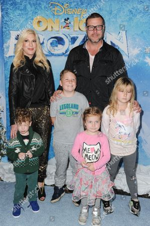 Finn McDermott, actress Tori Spelling, Liam McDermott, actor Dean McDermott, Hattie McDermott and Stella McDermott attend Frozen celebrity premiere presented by Disney On Ice held at the Staples Center on Thursday, Dec.10, 2015, in Los Angeles