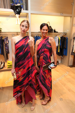 From left, Brianna Barnes and Lori Gladstone pose during the Halston Heritage boutique opening at Fashion Island, in Newport Beach, Calif