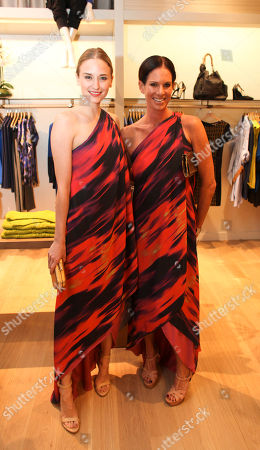 Stock Picture of From left, Brianna Barnes and Lori Gladstone pose during the Halston Heritage boutique opening at Fashion Island, in Newport Beach, Calif