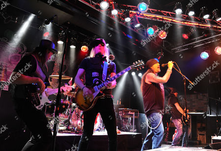 Danny Koker, and his band Zito 77 perform live at the Kim Kouture Fall 2013 fashion show benefitting Shiloh Horse Rescue at Count's Vamp'd, in Las Vegas, NV