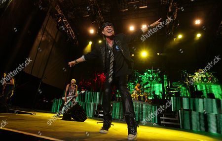 Pawel Maciwoda, Rudolf Schenker, Klaus Meine and James Kottak of the Scorpions perform on Friday at Charter One Pavilion at Northerly Island in Chicago