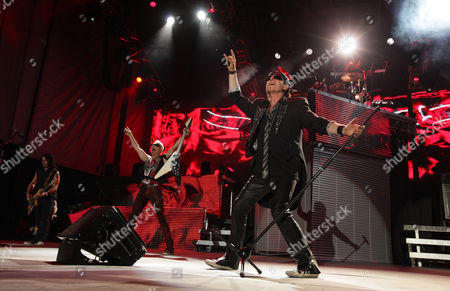 Pawel Maciwoda, Rudolf Schenker and Klaus Meine of the Scorpions perform on Friday at Charter One Pavilion at Northerly Island in Chicago