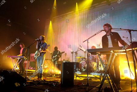 Dominic Simper, from left, Kevin Parker, Cam Avery, Julien Barbagallo and Jay Watson of the band Tame Impala perform in concert during their Currents Tour 2015 at the Tower Theater, in Upper Darby, Pa