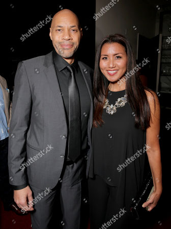 Stock Photo of John Ridley, left, and Gayle Yoshida attend The Hollywood Reporter Nominees Night presented by Cadillac, Bing, Delta, Pandora jewelry, Qua, and Zenith, at Spago, in Beverly Hills, Calif