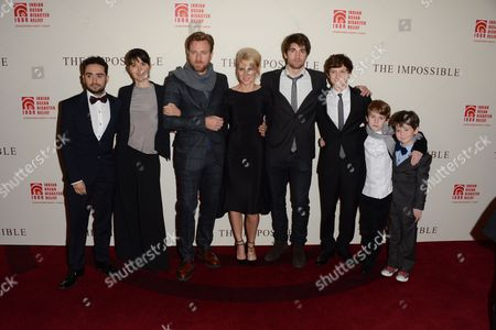 Stock Image of L-R) Director Juan Antionio Bayona, film subject Maria Belon, actor Ewan McGregor, actress Naomi Watts, film subject Lucas Belon and actors Tom Holland, Samual Joslin and Oaklee Pendergast are seen at the UK Premiere of The Impossible at Odeon BFI IMAX, in London