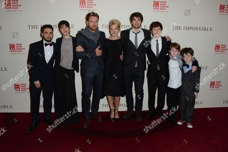 Stock Photo of L-R) Director Juan Antionio Bayona, film subject Maria Belon, actor Ewan McGregor, actress Naomi Watts, film subject Lucas Belon and actors Tom Holland, Samual Joslin and Oaklee Pendergast are seen at the UK Premiere of The Impossible at Odeon BFI IMAX, in London