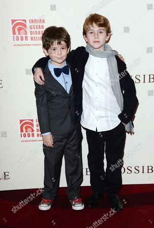 L-R) Actors Oaklee Pendergast and Samuel Joslin are seen at the UK Premiere of The Impossible at Odeon BFI IMAX, in London