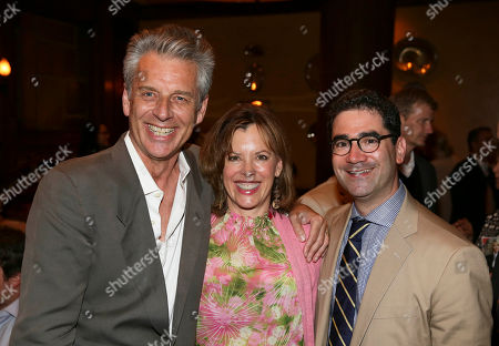 """Stock Photo of From left, CTG Artistic Director Michael Ritchie, Jeanie Hackett and Playwright Jonathan Tolins pose during the party for the night performance of """"Buyer & Cellar"""" at the Center Theatre Group/Mark Taper Forum, in Los Angeles, Calif"""