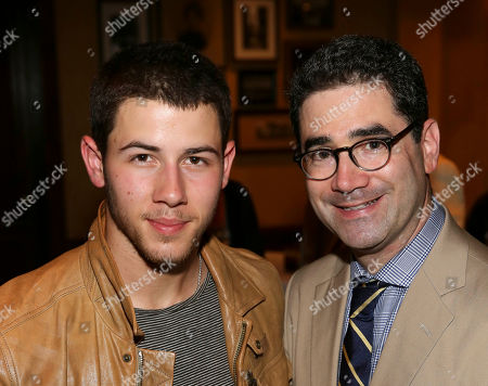 """From left, singer/actor Nick Jonas and Playwright Jonathan Tolins pose during the party for the opening night performance of """"Buyer & Cellar"""" at the Center Theatre Group/Mark Taper Forum, in Los Angeles, Calif"""