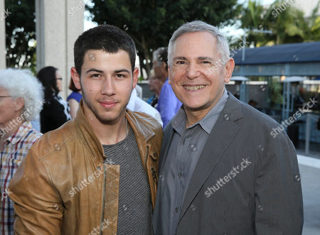 """From left, singer/actor Nick Jonas and Theatre and Movie Producer Craig Zadan arrive for the opening night performance of """"Buyer & Cellar"""" at the Center Theatre Group/Mark Taper Forum, in Los Angeles, Calif"""