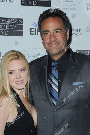 Brad Garrett, at left, and Isaball Quella attends the 100th Anniversary of The Beverly Hills Hotel - Day 1 on in Beverly Hills, Calif