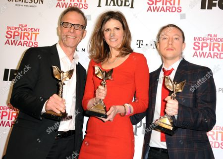 "Stock Picture of Director Kirby Dick, left, producer Amy Ziering, center, and producer Tanner King Barklow pose backstage with the award for best documentary for ""The Invisible War"" at the Independent Spirit Awards, in Santa Monica, Calif"