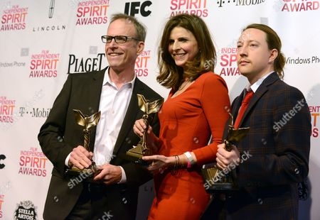 "Stock Image of Director Kirby Dick, left, producer Amy Ziering, center, and producer Tanner King Barklow pose backstage with the award for best documentary for ""The Invisible War"" at the Independent Spirit Awards, in Santa Monica, Calif"