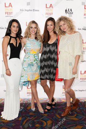 """Stock Picture of From left, Brooke Stone, Teresa Palmer, Gemma Pranita, and Amber L'estrange arrive at the 2014 Los Angeles Film Festival - """"The Ever After"""" Premiere on in Los Angeles"""