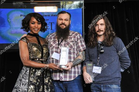From left, Angela Bassett, James M. Johnston, Toby Halbrooks seen at the 2014 Film Independent Filmmaker Grant and Spirit Awards Nominees Brunch on in West Hollywood, Calif
