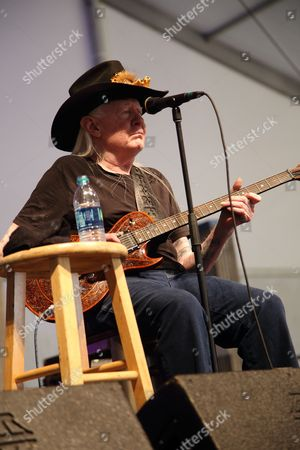 Johnny Winter performs at the 2014 New Orleans Jazz & Heritage Festival at Fair Grounds Race Course, in New Orleans