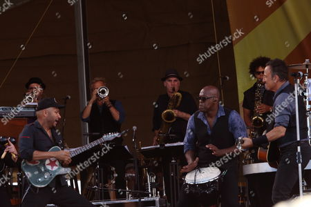 Tom Morello, Everett Bradley, Bruce Springsteen (L-R) and the E Street Band with special guest Rickie Lee Jones performs at the 2014 New Orleans Jazz & Heritage Festival at Fair Grounds Race Course, in New Orleans