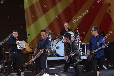 Roy Bittan, Bruce Springsteen, Max Weinberg (drums), Nils Lofgren, and Garry Tallent (L-R) and the E Street Band performs at the 2014 New Orleans Jazz & Heritage Festival at Fair Grounds Race Course, in New Orleans