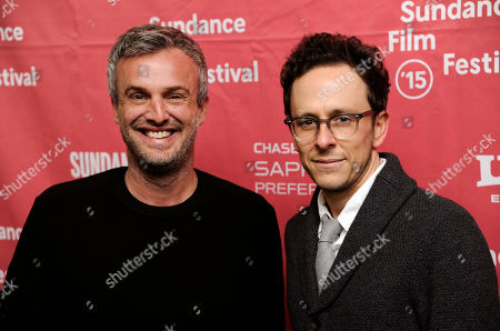 """Andrew Mogel, left, and Jarrad Paul, co-directors and co-writers of """"The D Train,"""" pose together at the premiere of the film at the Library Center Theatre during the 2015 Sundance Film Festival, in Park City, Utah"""