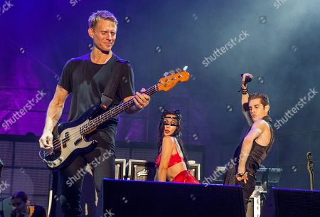 Chris Chaney, Etty Farrell and Perry Farrell perform with Janes Addiction at the Voodoo Music Experience, in New Orleans
