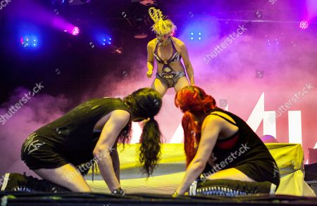 In center, Merrill Beth Nisker performs as Peaches at the Voodoo Music Experience, in New Orleans