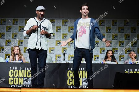 """Jesse L. Martin, left, and Grant Gustin tap dance on stage at """"The Flash"""" panel on day 3 of Comic-Con International, in San Diego. Looking on from background from left, Danielle Panabaker, Candice Patton, and Keiynan Lonsdale"""