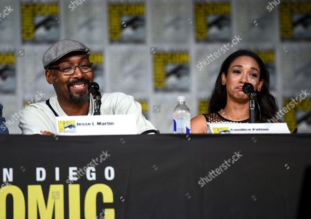 """Jesse L. Martin, left, and Candice Patton attend """"The Flash"""" panel on day 3 of Comic-Con International, in San Diego"""