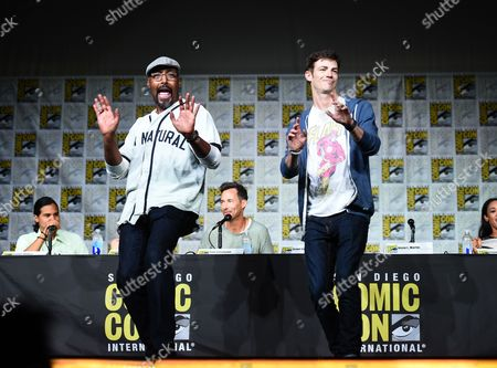"""Jesse L. Martin, left, and Grant Gustin tap dance on stage at """"The Flash"""" panel on day 3 of Comic-Con International, in San Diego"""