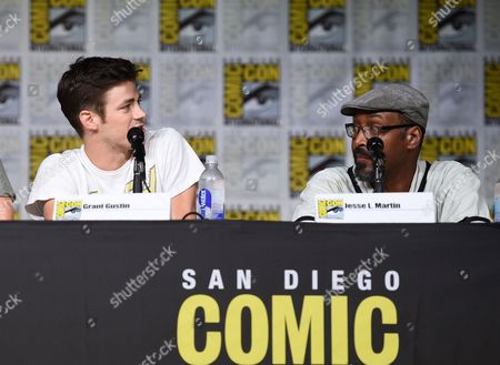 """Grant Gustin, left, and Jesse L. Martin attend """"The Flash"""" panel on day 3 of Comic-Con International, in San Diego"""