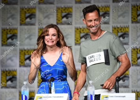 "Danielle Panabaker, left, and Tom Cavanagh attend ""The Flash"" panel on day 3 of Comic-Con International, in San Diego"