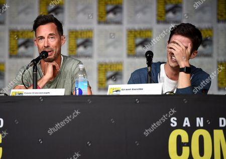 "Tom Cavanagh, left, and Grant Gustin attend ""The Flash"" panel on day 3 of Comic-Con International, in San Diego"