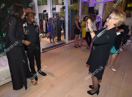 SAG-AFTRA President Gabrielle Carteris, right, takes a photo of Dawnn Lewis, from left, and Dante Brown at the Dynamic & Diverse Nominee Reception presented by the Television Academy and SAG-AFTRA at the Academy's Saban Media Center, in the NoHo Arts District in Los Angeles