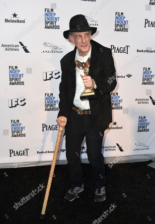 Ed Lachman poses in the press room with the award for best cinematography for Carol at the Film Independent Spirit Awards, in Santa Monica, Calif