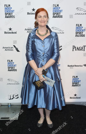"""Emma Donoghue poses with the award for best first screenplay for Room"""" in the press room at the Film Independent Spirit Awards, in Santa Monica, Calif"""