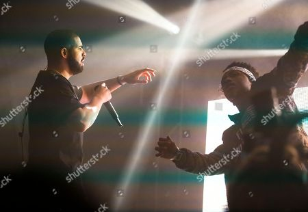 Metro Boomin, right, joins Drake for his performance on stage at the FADER FORT Presented by Converse during the South by Southwest Music Festival, in Austin, Texas