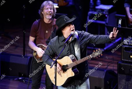 Stock Picture of Garth Brooks and Sam Bush perform during the 54th Annual ASCAP Country Music Awards at the Ryman Auditorium on in Nashville, Tenn