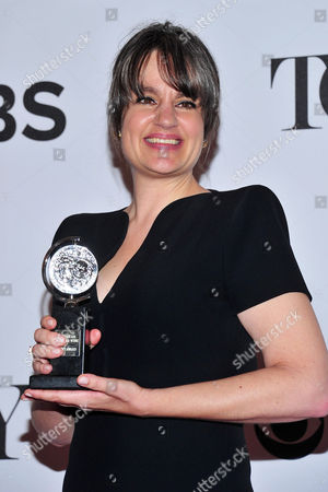 "Pam MacKinnon poses with her award for best direction of a play for ""Who's Afraid of Virginia Woolf?"" in the press room at the 67th Annual Tony Awards, on in New York"