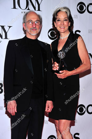 Peggy Eisenhauer and Jules Fisherposes pose with their award in the press room at the 67th Annual Tony Awards, on in New York