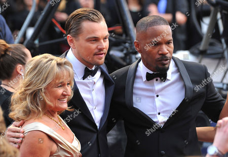 From left, Irmelin Indenbirken, Leonardo DiCaprio and Jamie Foxx arrive at the Oscars, at the Dolby Theatre in Los Angeles