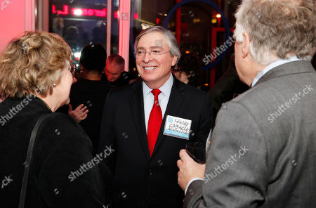 Alfredo Cabrera talks to Kathleen Christensen and Paul L. Joskow at the NYAM Age Smart Awards funded by the Alfred P. Sloan Foundation, on in New York