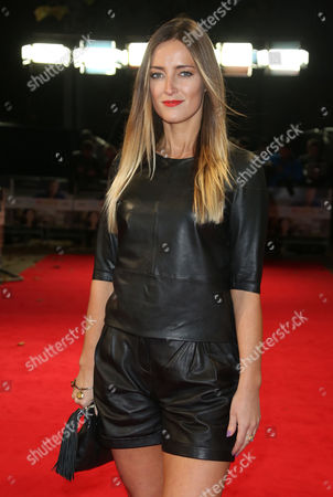 Francesca Newman-Young poses for photographers upon arrival at at the Kensington Odeon in west London, for the premiere of the film The Rewrite