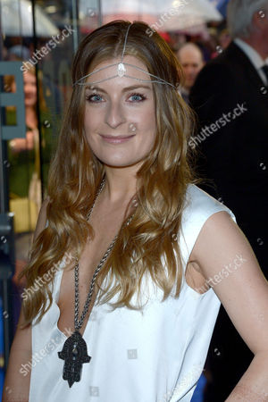Singer Molly Smitten-Downes poses for photographers for the UK premiere of X-Men: Days Of Future Past, in London on