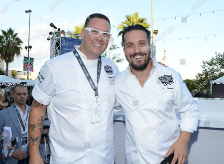 Chefs Graham Elliot, left, and Fabio Viviani attend the Ultimate Bites of L.A. presented by Chase Sapphire Preferred, at the Los Angeles Food & Wine Festival, presented by FOOD & WINE, on in Los Angeles