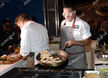 Chefs Graham Elliot, right, and Ben Ford participate in the Chase Sapphire Preferred Chef Challenge during the Ultimate Bites of L.A. at the Los Angeles Food & Wine Festival, presented by FOOD & WINE, on in Los Angeles